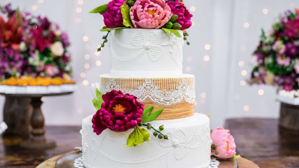 Why are cakes a must in weddings?